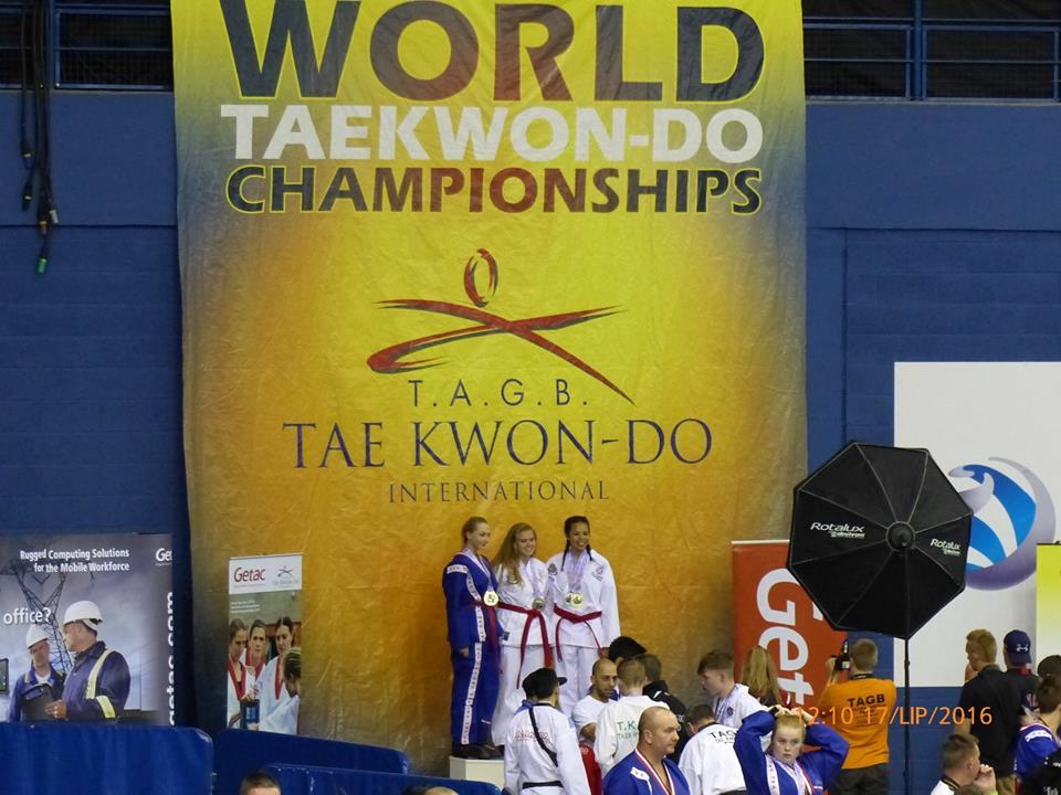 Team USA-Asia with international team mate on podium